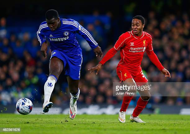 Kurt Zouma of Chelsea clears the danger from Raheem Sterling of Liverpool during the Capital One Cup SemiFinal second leg between Chelsea and...