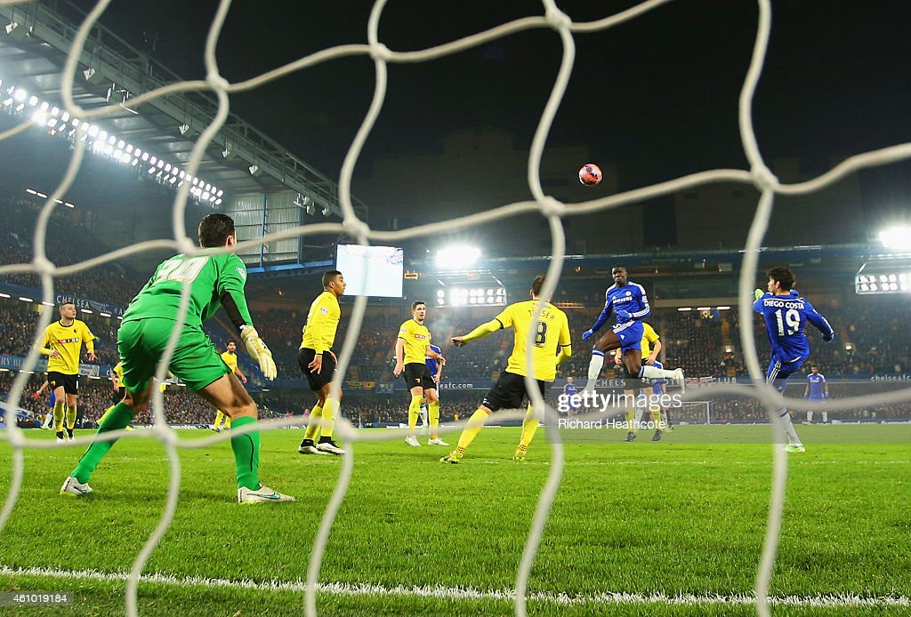 Kurt Zouma of Chelsea heads past goalkeeper Jonathan Bond of Watford to score their third goal during the FA Cup Third Round match between Chelsea and Watford at Stamford Bridge on January 4, 2015 in London, England.