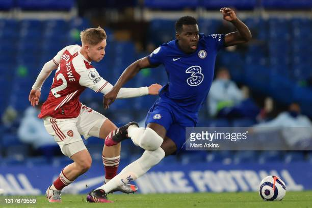 Kurt Zouma of Chelsea is challenged by Emile Smith Rowe of Arsenal during the Premier League match between Chelsea and Arsenal at Stamford Bridge on...