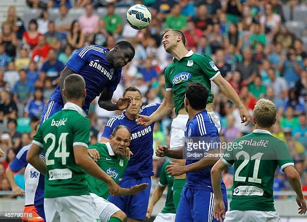 Kurt Zouma of Chelsea jump for the ball against Boban Jovic of FC Olimpija Ljubljana during the Pre Season Friendly match between FC Olimpija...