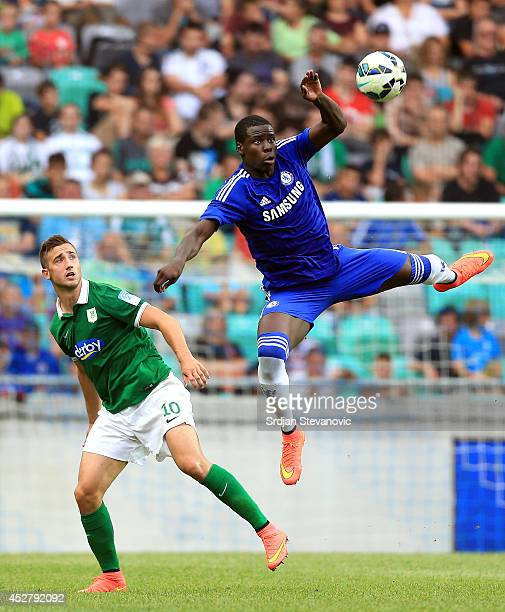 Kurt Zouma of Chelsea jump for the ball near Andraz Sporar of FC Olimpija Ljubljana during the Pre Season Friendly match between FC Olimpija...