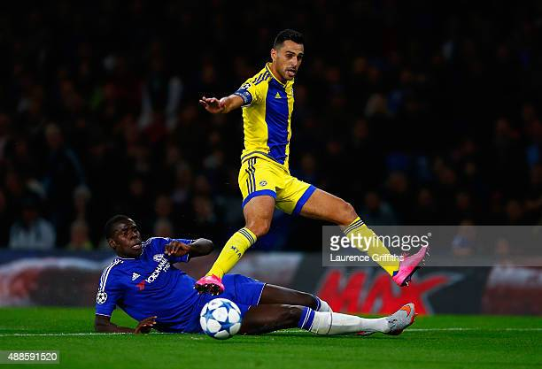 Kurt Zouma of Chelsea tackles Eran Zahavi of Maccabi Tel Aviv during the UEFA Chanmpions League group G match between Chelsea and Maccabi TelAviv FC...