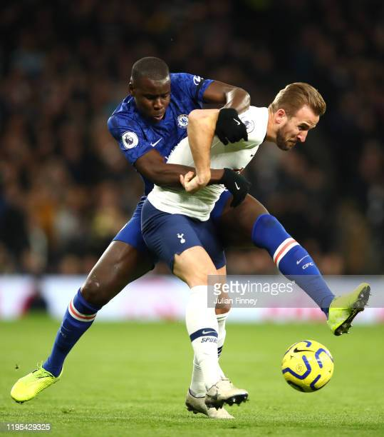 Kurt Zouma of Chelsea tackles Harry Kane of Tottenham Hotspur during the Premier League match between Tottenham Hotspur and Chelsea FC at Tottenham...
