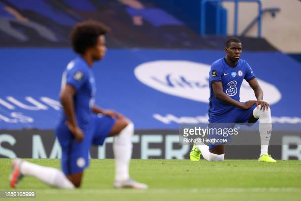 Kurt Zouma of Chelsea takes a knee in support of the Black Lives Matter movement prior to the Premier League match between Chelsea FC and Norwich...