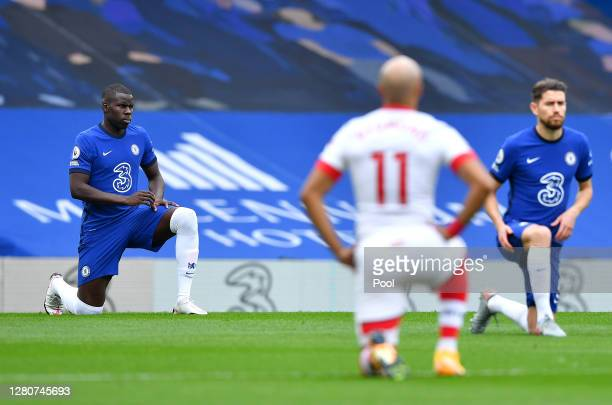 Kurt Zouma of Chelsea takes a knee in support of the Black Lives Matter movement prior to the Premier League match between Chelsea and Southampton at...