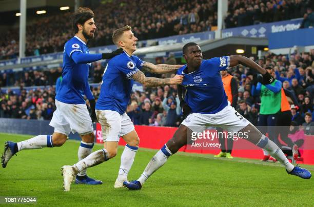 Kurt Zouma of Everton celebrates after scoring his team's first goal with Lucas Digne and Andre Gomes during the Premier League match between Everton...