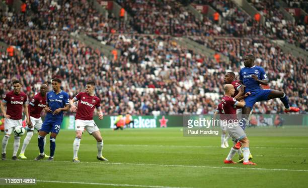 Kurt Zouma of Everton scores his team's first goal during the Premier League match between West Ham United and Everton FC at London Stadium on March...