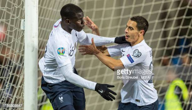 Kurt Zouma of France celebrates with team mate Wissam Ben Yedder of France after scoring his team's fourth goal during the UEFA Euro 2020 Qualifier...