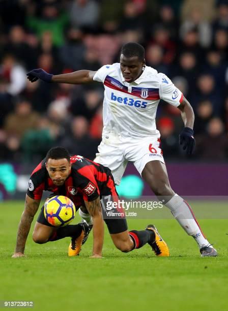 Kurt Zouma of Stoke City and Callum Wilson of AFC Bournemouth clash during the Premier League match between AFC Bournemouth and Stoke City at...