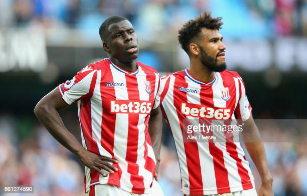 Kurt Zouma of Stoke City and Maxim ChoupoMoting of Stoke City react during the Premier League match between Manchester City and Stoke City at Etihad...