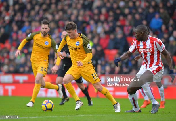 Kurt Zouma of Stoke City chases down Pascal Gross of Brighton and Hove Albion during the Premier League match between Stoke City and Brighton and...