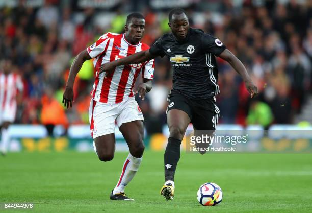 Kurt Zouma of Stoke City chases Romelu Lukaku of Manchester United during the Premier League match between Stoke City and Manchester United at Bet365...