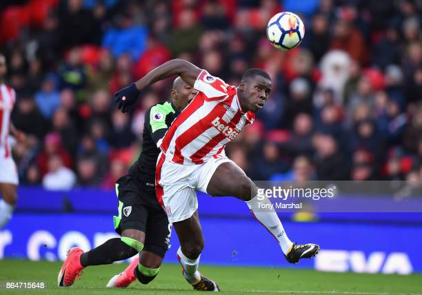 Kurt Zouma of Stoke City is tackled by Benik Afobe of AFC Bournemouth during the Premier League match between Stoke City and AFC Bournemouth at...