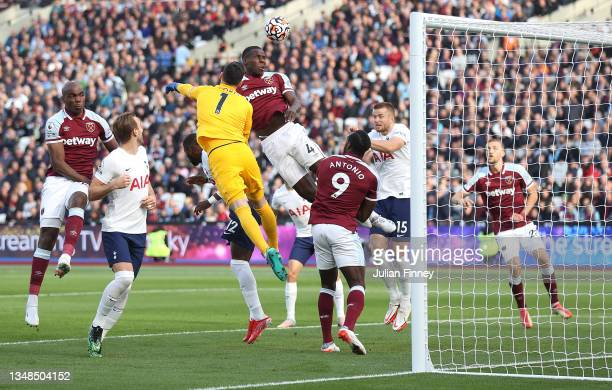 Kurt Zouma of West Ham United competes for a header with Hugo Lloris of Tottenham Hotspur during the Premier League match between West Ham United and...