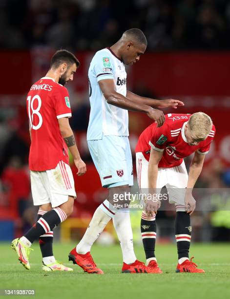 Kurt Zouma of West Ham United embraces Donny van de Beek of Manchester United after the Carabao Cup Third Round match between Manchester United and...