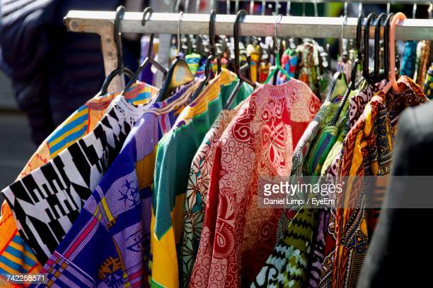 kurtas hanging on rack in market for sale - kurta stock pictures, royalty-free photos & images