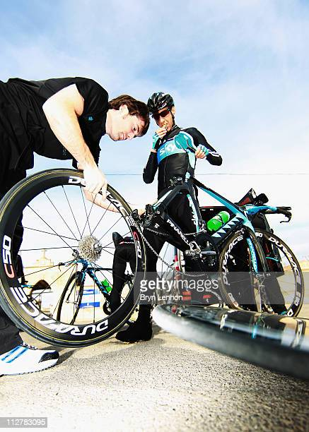 KurtAsle Arevesen of Norway receives a wheel change during a SKY Procycling team training camp in Puerto Alcudia on January 19 2011 in Mallorca Spain