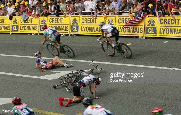 KurtAsle Arvesen of Norway and riding for CSC and Jimmy Casper of France and riding for Cofidis lie on the course after they crashed in the final 200...