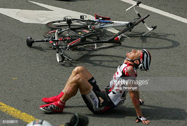 KurtAsle Arvesen of Norway and riding for CSC sits on the road after being involved in a crash with Jimmy Casper of France in the final 200 meters of...