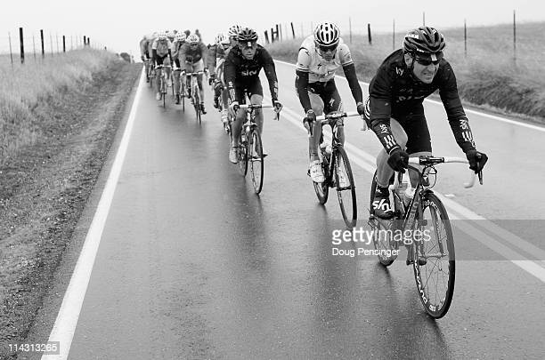 KurtAsle Arvesen of Norway riding for Sky Procycling leads the peloton as they roll through the countryside as they battle wind and weather in...