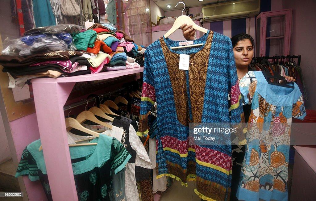 Kurtis can be seen displayed at the Lajpat Nagar market in New Delhi on April 21, 2010.