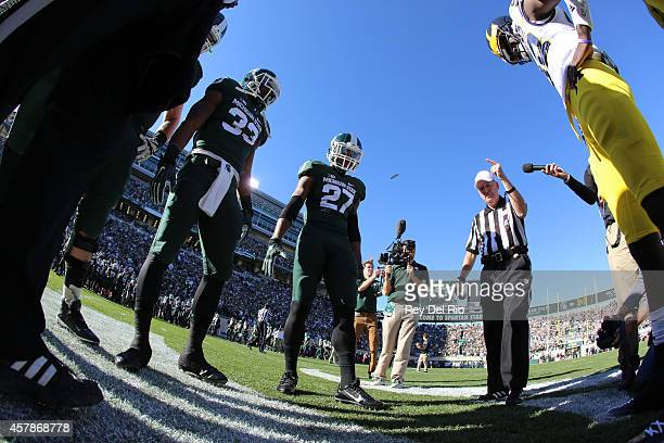 Kurtis Drummond and Jeremy Langford of the Michigan State Spartans during the coin toss against the Michigan Wolverines at Spartan Stadium on October...