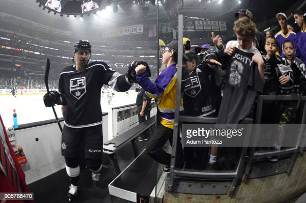 Kurtis MacDermid of the Los Angeles Kings highfives fans before a game against the San Jose Sharks at STAPLES Center on January 15 2018 in Los...