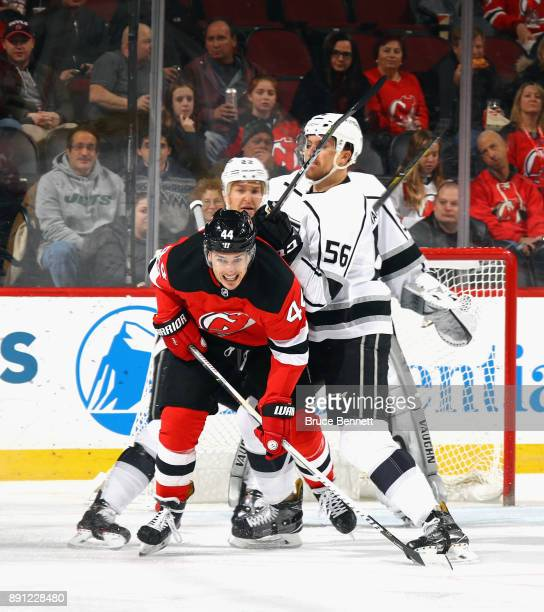 Kurtis MacDermid of the Los Angeles Kings moves Miles Wood of the New Jersey Devils out of the crease during the first period at the Prudential...