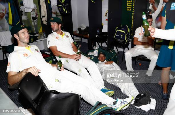 Kurtis Patterson Joe Burns and Usman Khawaja of Australia celebrate in the change rooms after day four of the Second Test match between Australia and...