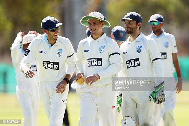Kurtis Patterson Nic Maddinson and Ryan Carters of the Blues walk from the field after the Voctorian first innings during day three of the Sheffield...