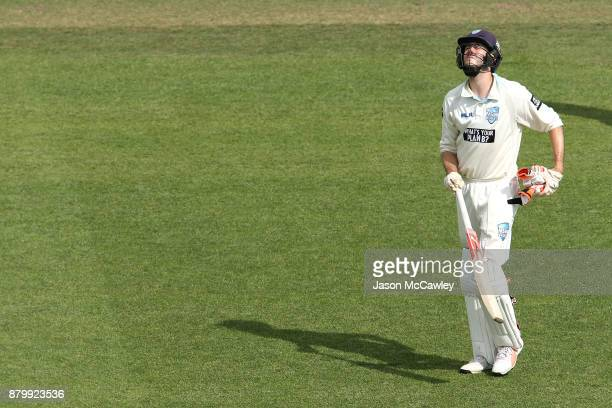 Kurtis Patterson of NSW looks dejected after being dismissed by Chris Tremain of Victoria during day four of the Sheffield Shield match between New...