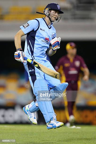 Kurtis Patterson of the Blues celebrates winning the Matador BBQs One Day Cup match between NSW Blues and QLD Bulls at The Gabba on October 10 2014...