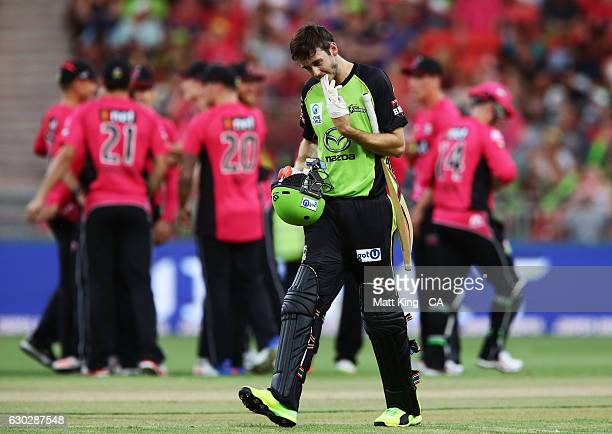 Kurtis Patterson of the Thunder walks from the field after being dismissed by Stephen O'Keefe of the Sixers during the Big Bash League match between...