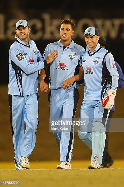 Kurtis Patterson Patrick Cummins and Peter Nevill of the Blues celebrate the wicket of Jonathan Wells of the Tigers during a Matador BBQs One Day Cup...