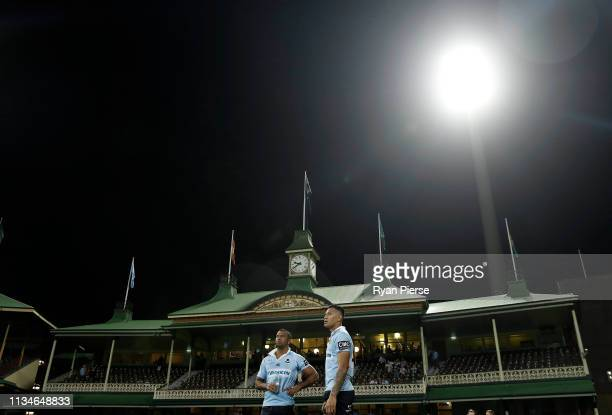 Kurtley Beale and Israel Folau of the Waratahs talk after the round four Super Rugby match between the NSW Waratahs and the Queensland Reds at the...