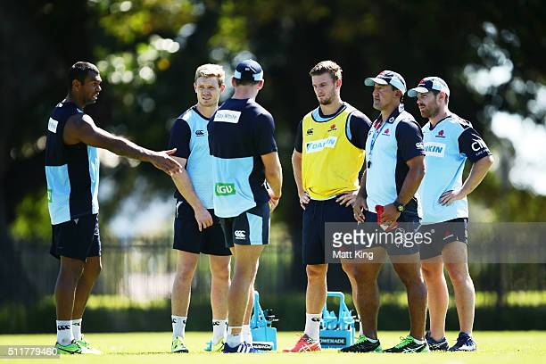 Kurtley Beale and Waratahs coach Daryl Gibson speak to players during a Waratahs Super Rugby training session at Kippax Lake on February 23 2016 in...