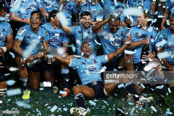 Kurtley Beale and Waratahs players celebrate victory and hold the Super Rugby trophy during the Super Rugby Grand Final match between the Waratahs...