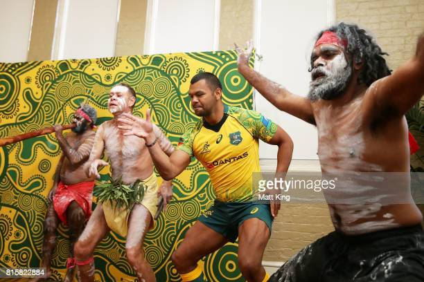 Kurtley Beale dances with Indigenous performers during the Wallabies Indigenous Jersey Launch at the National Centre of Indigenous Excellence on July...