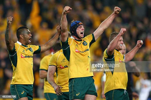 Kurtley Beale Dean Mumm and James Slipper of the Wallabies celebrate winning the Rugby Championship match between the Australia Wallabies and the New...