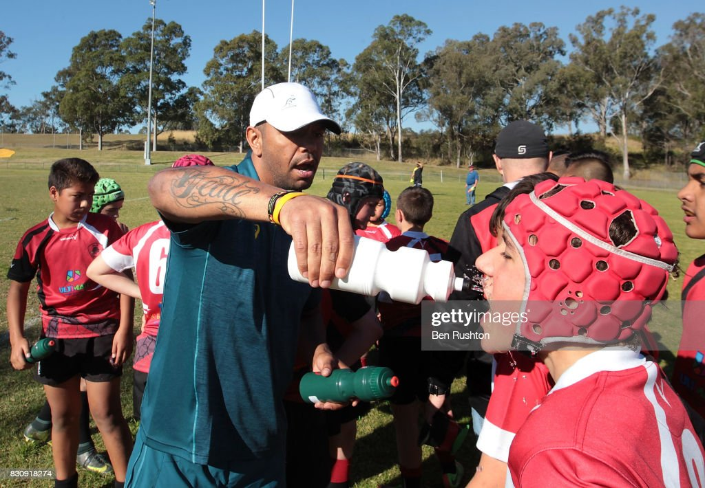 Kurtley Beale gives water to the junior teams during an Australian Wallabies fan day on August 13, 2017 in Penrith, Australia.