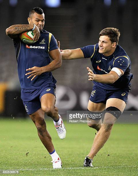 Kurtley Beale is tackled by Luke Jones during an Australian Wallabies captain's run at Etihad Stadium on June 13 2014 in Melbourne Australia