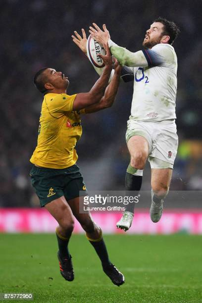 Kurtley Beale of Australia and Elliot Daly of England battle for the ball during the Old Mutual Wealth Series match between England and Australia at...
