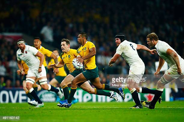Kurtley Beale of Australia breaks with the ball to pass to Bernard Foley of Australia for their second try during the 2015 Rugby World Cup Pool A...