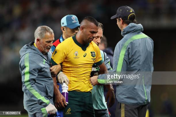 Kurtley Beale of Australia is assisted off the pitch by medical staff during the Rugby World Cup 2019 Group D game between Australia and Georgia at...