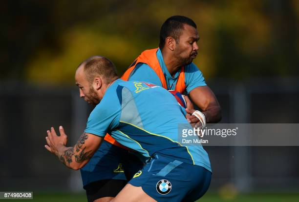 Kurtley Beale of Australia is tackled by Billy Meakes of Australia during a training session at the Lensbury Hotel on November 16 2017 in London...