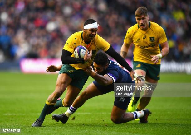 Kurtley Beale of Australia is tackled by Darryl Marfo of Scotland during the international match between Scotland and Australia at Murrayfield...