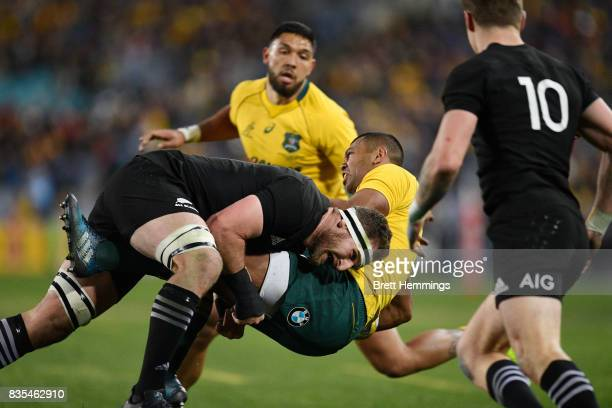 Kurtley Beale of Australia is tackled by Kieran Read of the All Blacks during The Rugby Championship Bledisloe Cup match between the Australian...