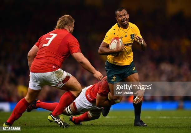Kurtley Beale of Australia is tackled by Taulupe Faletau of Wales during the Under Armour Series match between Wales and Australia at Principality...