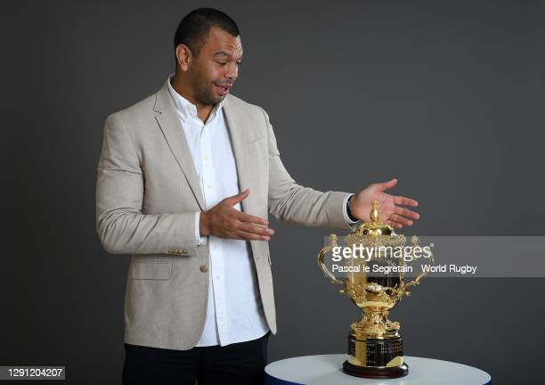 Kurtley Beale of Australia poses with The Webb Ellis Cup prior to the Rugby World Cup France 2023 draw at Palais Brongniart on December 14, 2020 in...