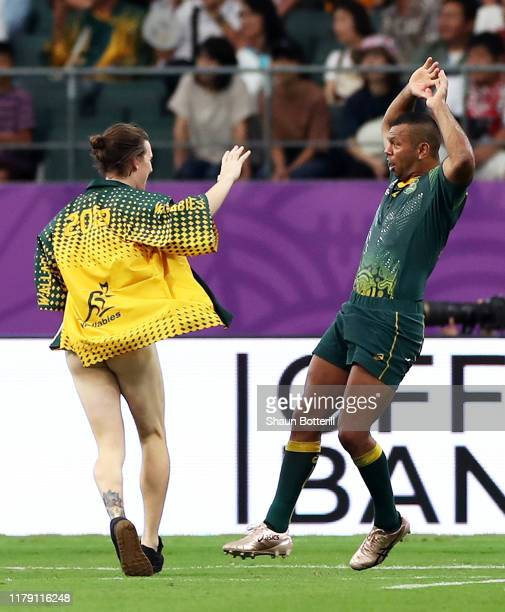 Kurtley Beale of Australia reacts to a streaker during the Rugby World Cup 2019 Group D game between Australia and Uruguay at Oita Stadium on October...